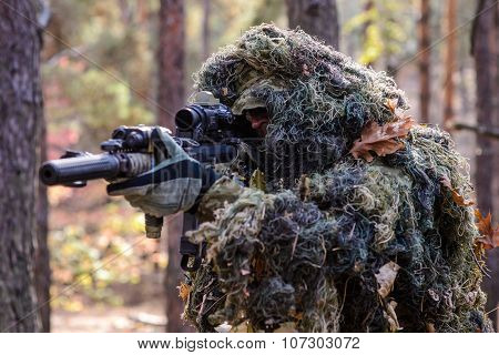 Armed Sniper In Camouflage Suit