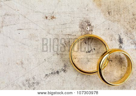 Wedding Rings On Dirty Canvas