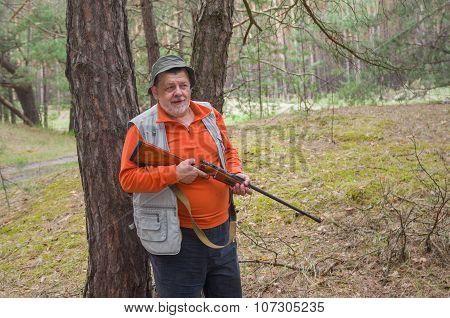 Positive portrait of senior ranger with rifle