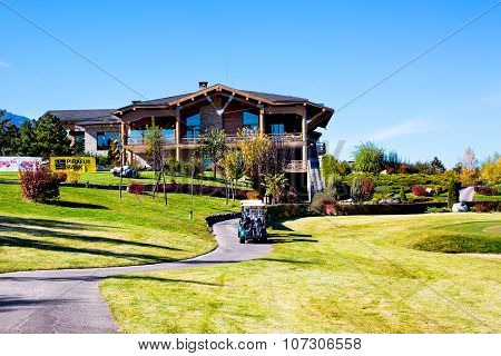 Pirin Golf Club house and restaurant, colorful autumn trees, golf cart, blue sky