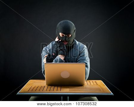 Hacker thinks how he will crack the laptop