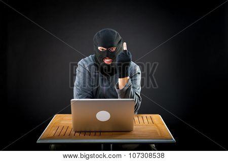 Brazen hacker showing middle finger