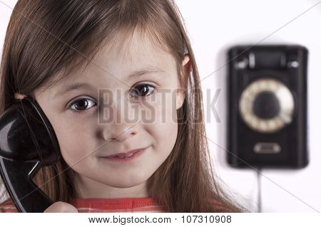 Laughing child talking on phone, white background
