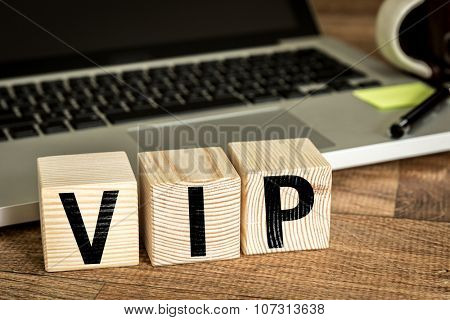 VIP written on a wooden cube in a office desk