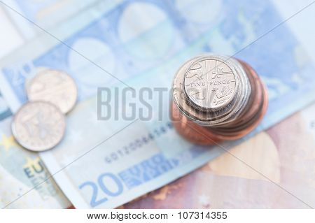 Five Pence Coins And Euro Notes