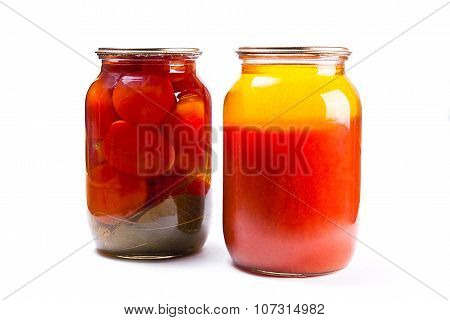 Glass Jars Of Canned Tomatoes And Tomatoes Juice On White Background.