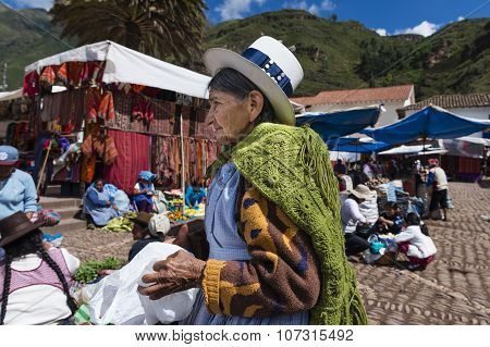 Local woman in a market in the city of Pisac in the Sacred Valley.