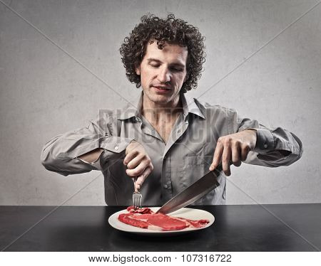 Man eating a raw beef