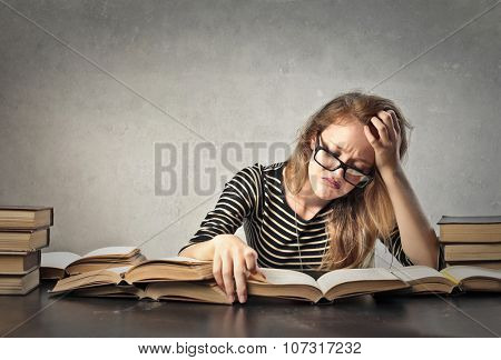 Bored young woman studying