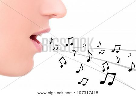 Music Concept - Close Up Of Female Mouth Singing Over White