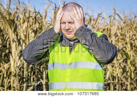 Depressed farmer at outdoor on cold corn field