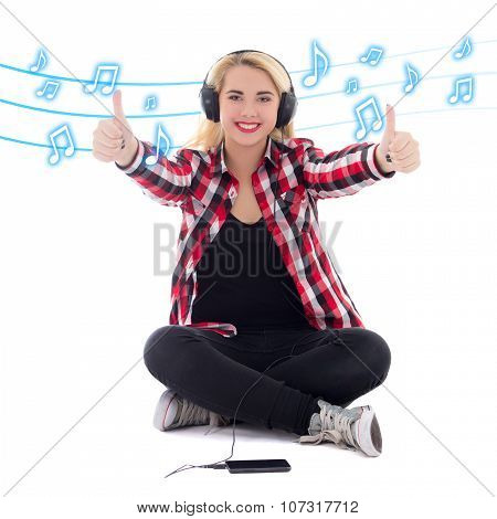 Happy Teenage Girl Listening Music In Earphones And Thumbs Up Over White