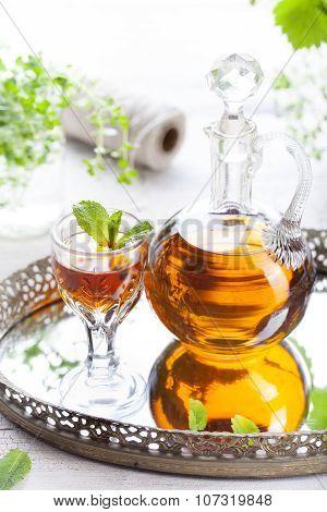 Herbal, mint homemade liquor. Russian traditional strong spirits
