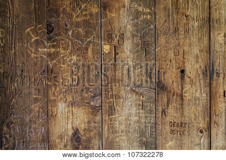 vandal graffiti on a wood wall of historic structure (covered bridge)