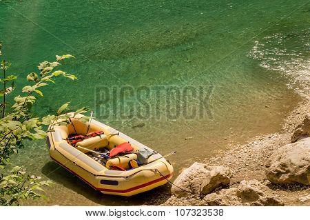 Yellow raft on a rocky riverbank