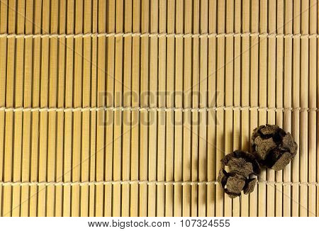 pine cones on bamboo background