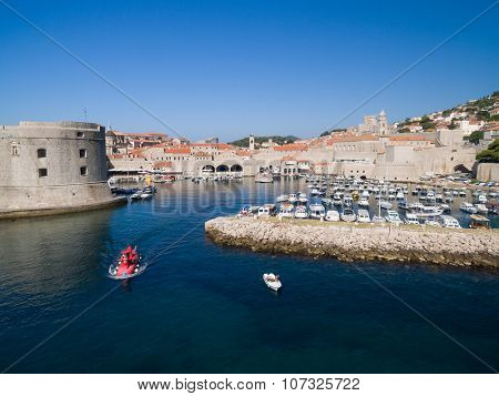 Aerial view of old port  in front of old city of Dubrovnik (Croatia). Dubrovnik is popular tourist attraction on Adriatic.