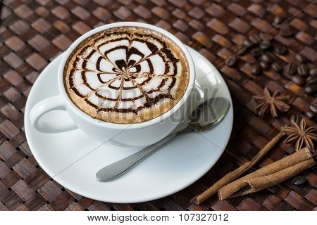 Coffee Latte In White Cup Decorated On Wooden Background, Latte Art.