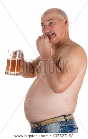 man with a big belly eat fish with a beer in hand