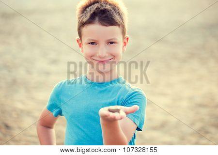 Little Boy Holding Gravel On Beach Vintage