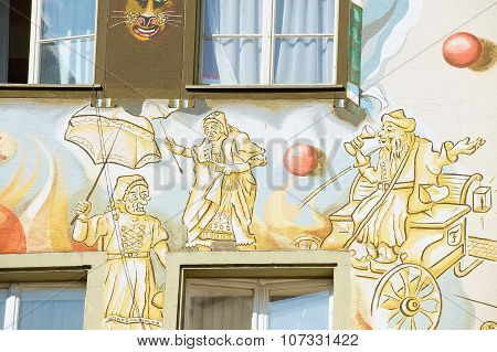 Exterior of the old frescos on the medieval building wall in Lucerne, Switzerland.