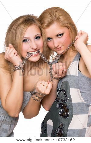 Two Playful Young Women Bound A Chain