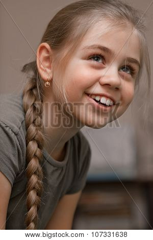 Smiling Girl With Braided Hair