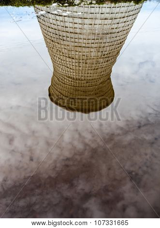 Cooling Tower Of The Cogeneration Plant Reflected In Water