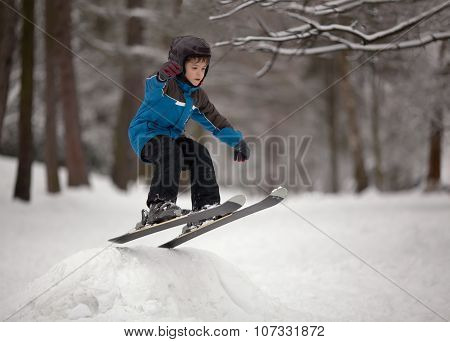 Little Boy Skier Jumping