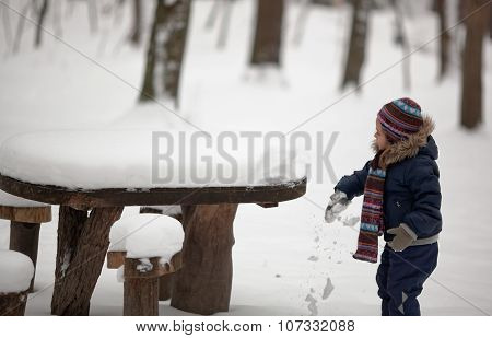 Child Explores Snow