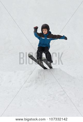 Child Snow Skiing And Jumping
