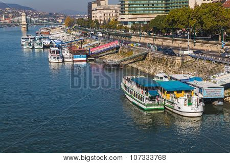 Boats Docked Along The Danube River In Budapest