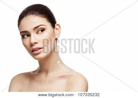 Girl with cream on neck