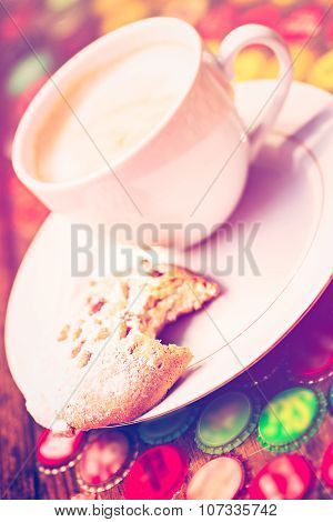 Hot coffee with Southern Italian cookie on the table.
