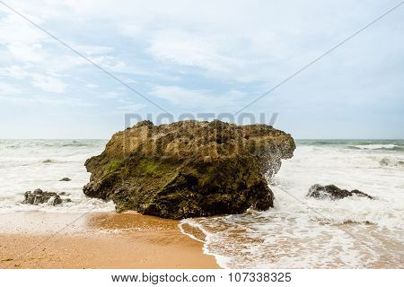 Ocean crashing over rock