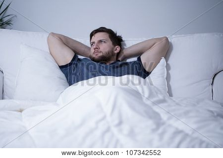 Handsome Man Lying In Bed