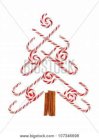 Christmas tree of candy canes and peppermint swirls over white