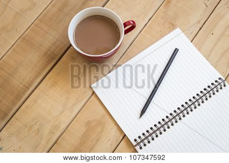 Top View Of Open Book And Coffee Cup On Wooden Table