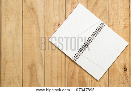 Top View Of Open Book On Wooden Table