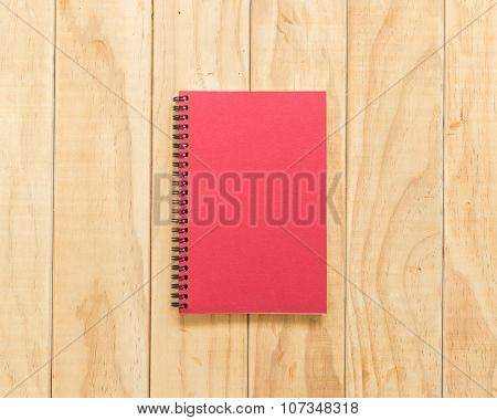 Top View Of Red Book On Wooden Table