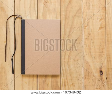 Top View Of Brown Book On Wooden Table