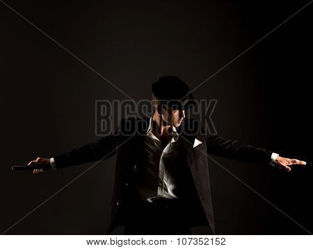 Studio photo of dancer dressed as gangster