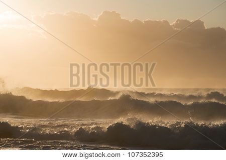 Positive Transparent Waves On Sunrise Bathing In Orange Light