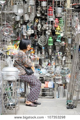 Vietnamese woman selling iron metal hand made handicraft products