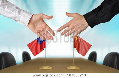 Taiwan and China diplomats agreeing on a deal