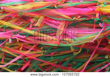 Strips of different colored fabric ribbons decorate a bodhi tree