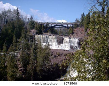 Northern Waterfalls And A Bridge