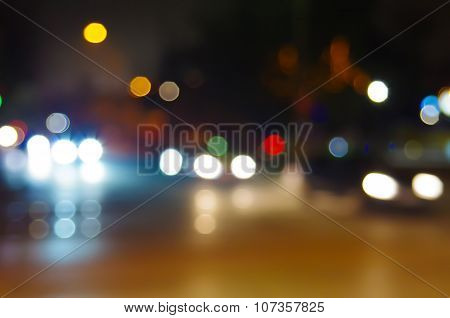 Abstract Blurry Spots Of Light In The Night City Street Scene