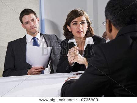 Businesswoman Negotiating With Men