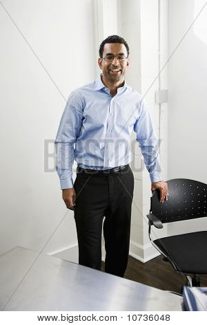 African American Man Standing In Office
